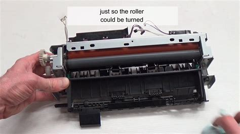 How to clean a printer fuser roller   YouTube