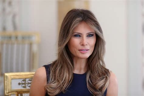 Melania Trump in Poland: See Her Colorful Dress & Purple ...